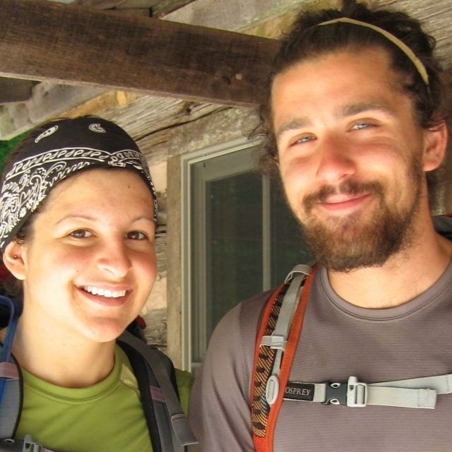 2-Hikers-Smiling-with-Back-Packs